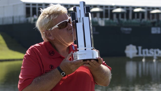 John Daly kisses the trophy after winning the Insperity Invitational golf tournament on Sunday, May 7, 2017, in The Woodlands, Texas.