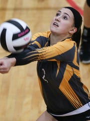 Crescent's Lucy Bryant digs saves a ball against Powdersville