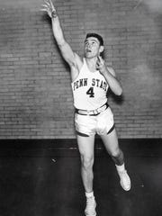 This photo, taken between 1953 and 1955, shows Bobby Hoffman in his Penn State basketball uniform, as seen Thursday, Feb. 4, 2016, in Hoffman's Lititz home. Hoffman was a defensive back and quarterback for Penn State's 1954 football team, and was one of four football players who also played in the university's 1954 basketball team -- the only Penn State team to reach the NCAA's Final Four.