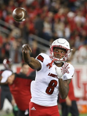 U of L QB Lamar Jackson (8) warms up before their game against the University of Houston.Nov. 17, 2016