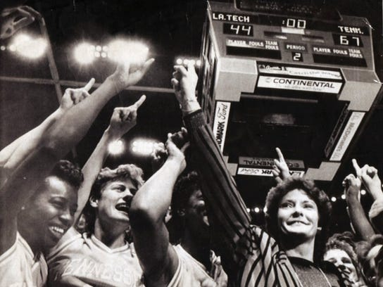 Pat Summitt leads the cheers after winning the women's