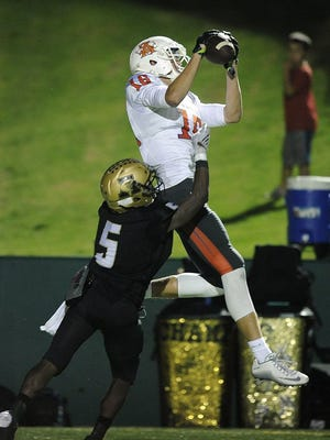 Thomas Metthe/ABILENE Reporter-News Abilene High defensive back David Earles (5) breaks up a pass intended for Central wide receiver Adam West (16) during the fourth quarter of the Eagles' 31-24 win last season at Abilene's Shotwell Stadium.
