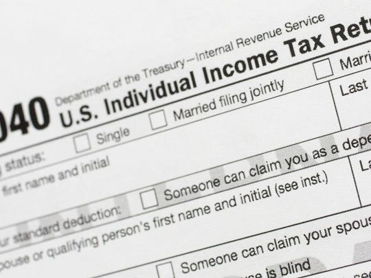 FILE - This July 24, 2018, file photo shows a portion of the 1040 U.S. Individual Income Tax Return form. The IRS began accepting and processing tax returns for individuals on Monday, Jan. 27, 2020. (AP Photo/Mark Lennihan, File)