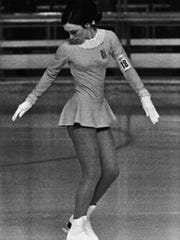 American figure skater Peggy Fleming competes in the 1968 Winter Olympics at Palais des Sports in Grenoble, Feb. 8, 1968. (AP Photo/Rider)