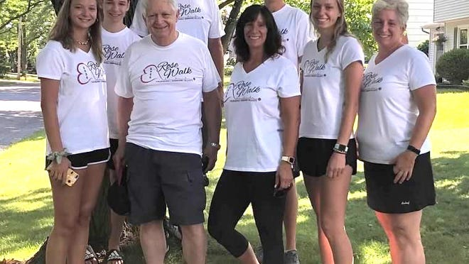 On July 18, the Valenzano, Simmons and Elliott families held their very own, scaled-down Rose Walk in Canandaigua despite UR Medicine Thompson Health's annual event being canceled due to COVID-19. In the front row, left to right, are Carly Elliott, Dr. Vito Valenzano, Penny Elliott, Rachel Simmons and Polly Simmons. In the back, left to right, are Casey Elliott, Alan Simmons and Scott Loforte.