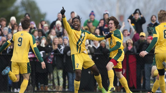 Vermont's Brian Wright (7) and Elliot Maker (27) celebrate Wright's first-half goal during the America East men's soccer championship game between the Binghamton Bearcats and the Vermont Catamounts at Virtue Field on Sunday afternoon.