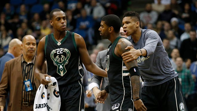 Milwaukee Bucks forward Giannis Antetokounmpo, right, and guard Khris Middleton, left, restrain guard O.J. Mayo, center, as he goes toward a referee after being assessed a second technical foul during the first half of an NBA basketball game against the Minnesota Timberwolves in Minneapolis on Saturday.