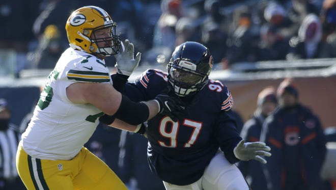 Green Bay Packers tackle Bryan Bulaga (75) blocks Chicago Bears outside linebacker Willie Young (97)  during  the first quarter Sunday, Dec. 18, 2016, at Soldier Field in Chicago.