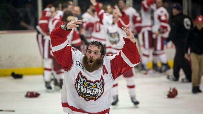 Prowlers' Ahmed Mahfouz celebrates winning the Commissioner's Cup playoffs Friday, April 22, 2016 at McMorran Arena.