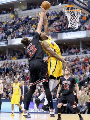 INDIANAPOLIS, IN - MARCH 06:  Ian Mahinmi #28 of the Indiana Pacers shoots the ball during the game against the Chicago Bulls at Bankers Life Fieldhouse on March 6, 2015 in Indianapolis, Indiana.  The Pacers won 98-84. NOTE TO USER: User expressly acknowledges and agrees that, by downloading and or using this Photograph, user is consenting to the terms and conditions of the Getty Images License Agreement.  (Photo by Andy Lyons/Getty Images)