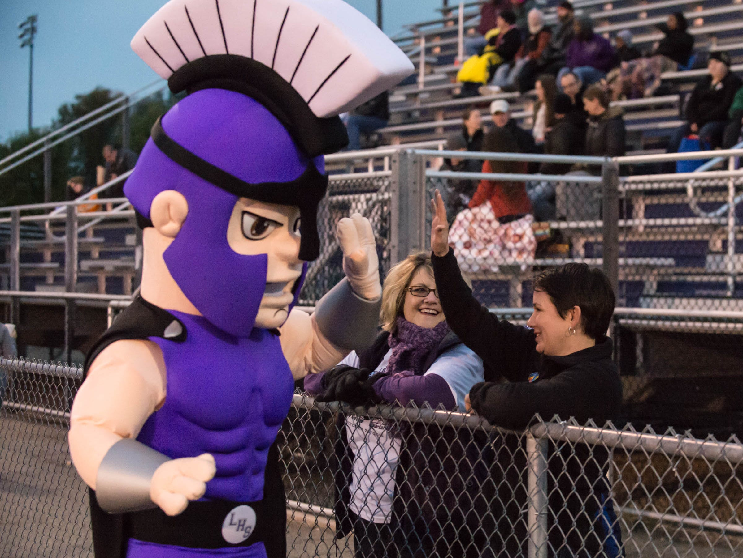 Lakeview mascot high-fives some Spartans fans before Friday's game against Gull lake.