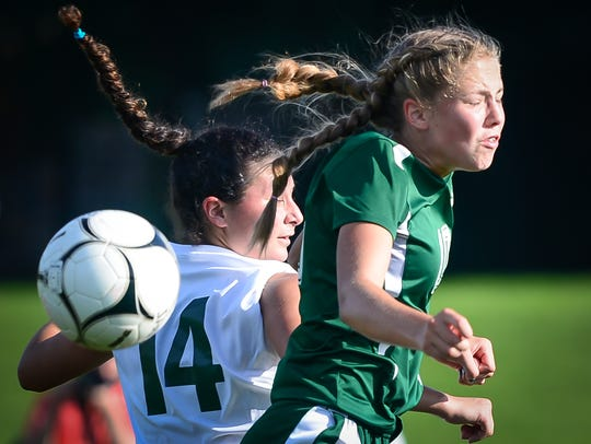 Fairfield's Zoe Logue battles York Catholic's Anabella