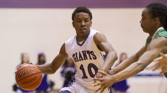 Ben Davis's Datrion Harper (10) makes a break to the basket, Feb. 20, 2015.