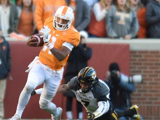 Tennessee quarterback Joshua Dobbs gets away from Missouri safety Cam Hilton during the first half at Neyland Stadium on Saturday.