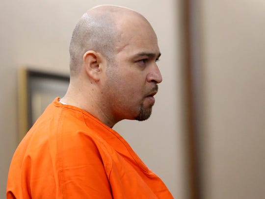 Arturo Garza attends a court hearing after he is accused