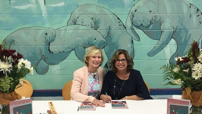 """Dr. Joyce Holmes, left, and Dr. Patricia Gage at a book signing of their book, """"Mrs. Feathergreen Might Be a Superhero"""" onOct.27at the Willoughby Learning Center in Stuart."""