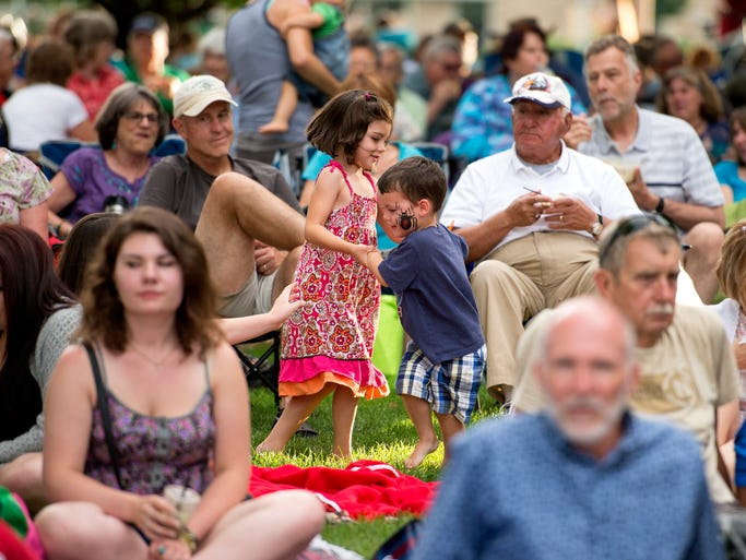 Piper, left, 5, and Harrison Fullerton, 3, dance together as Danielle Ate the Sandwich performs during the Lagoon Concert Series on Colorado State University campus in Fort Collins Wednesday, July 9, 2014.