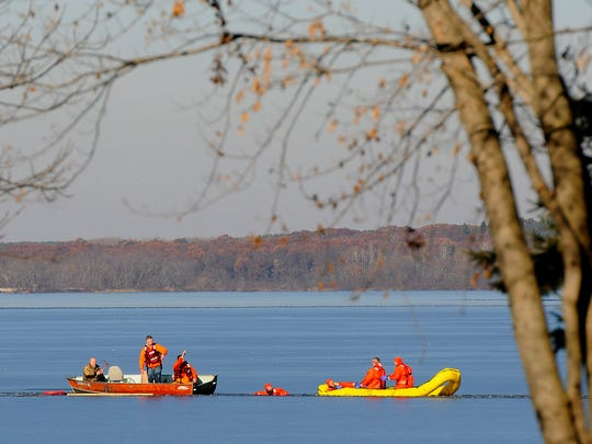 Rescue workers attempt to find Josh Johnson, who went