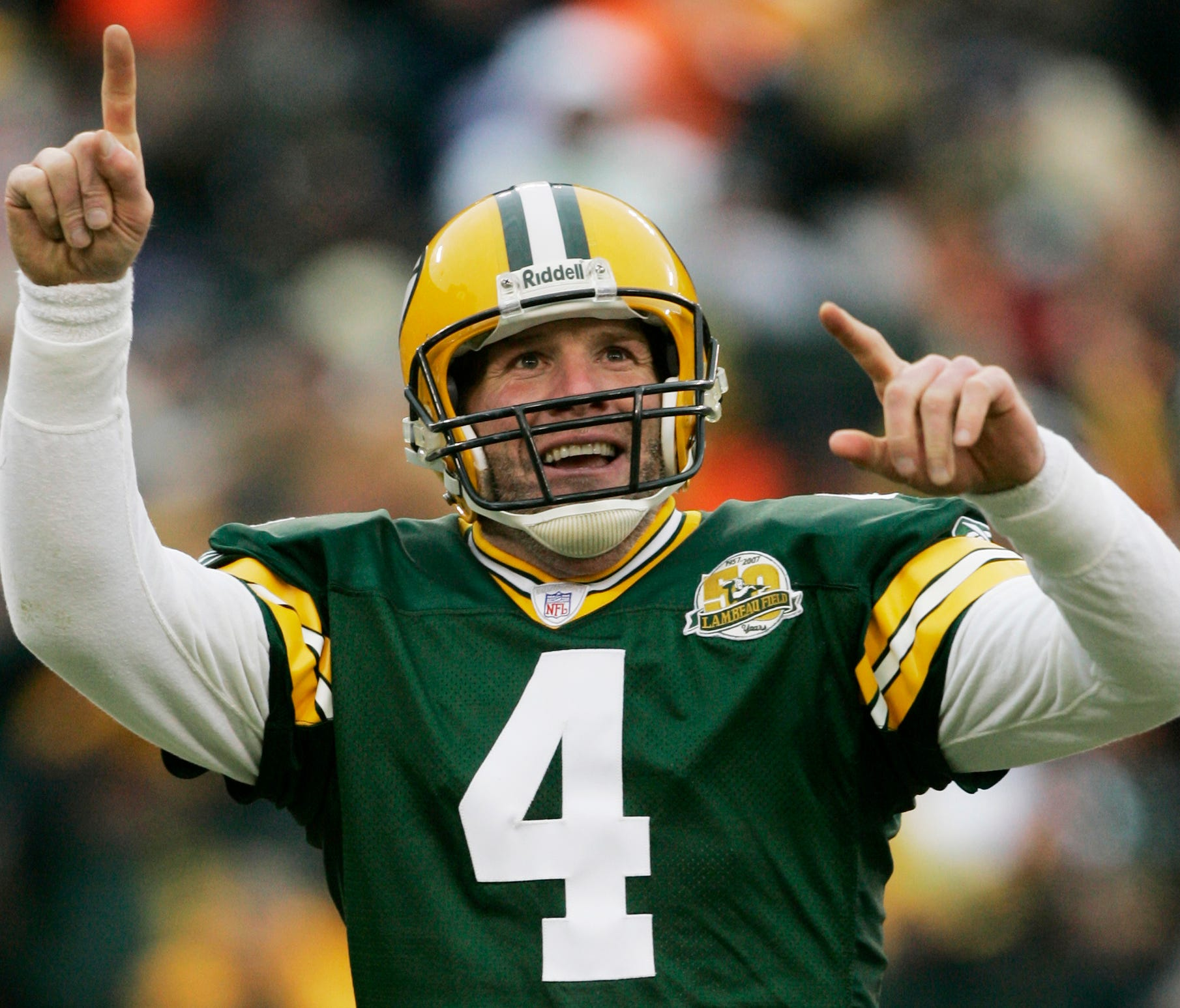 FILE - In this Dec. 9, 2007 file photo, Green Bay Packers quarterback Brett Favre reacts to a 46-yard touchdown pass to tight end Donald Lee during the second half of an NFL football game against the Oakland Raiders in Green Bay, Wis.  Favre will be