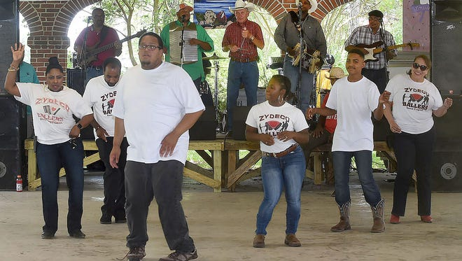 The Zydeco Ballers dance team entertain at the Juneteenth Folklife Celebration held Saturday at the Wilbert Guillory Memorial Farmers Market Pavilion in Opelousas.