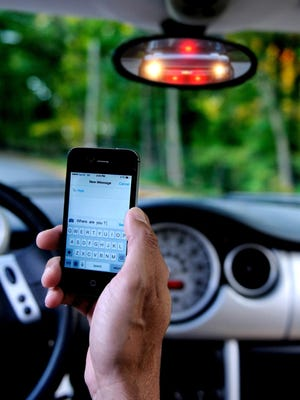 This Poughkeepsie Journal photo illustration depicts distracted driving.