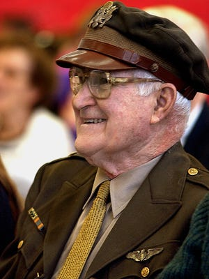 Ralph Adams, of Adams Fairacre Farms, enjoys a sing-along performance in 2008 for veterans at West Road Elementary School in Pleasant Valley while wearing his United States Army Air Corps uniform. He attended the special event to watch his grandson sing. Adams died Friday at age 91.