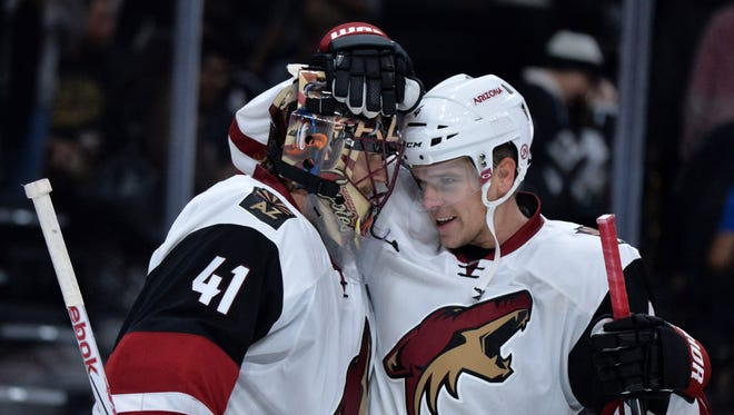 Oct 9, 2015: Arizona Coyotes goalie Mike Smith (41) celebrates with defenseman Zbynek Michalek (4) after 4-1 victory against the Los Angeles Kings at Staples Center.