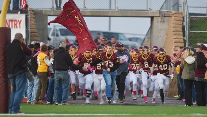 Harrisburg runs out onto the field before the game against Mitchell Friday, Oct. 13, in Harrisburg.