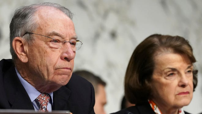 Senate Judiciary Committee Chair Sen. Chuck Grassley, R-Iowa, left, and Ranking Member Sen. Dianne Feinstein, D-Calif., listen to testimony during a committee hearing on March 14.