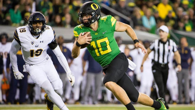 Sep 30, 2017; Eugene, OR, USA; Oregon Ducks quarterback Justin Herbert (10) scores a touchdown during the first half in a game against the California Golden Bears at Autzen Stadium. Mandatory Credit: Troy Wayrynen-USA TODAY Sports