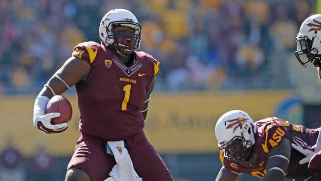 ASU defensive lineman Marcus Hardison carries the ball after an interception during the second quarter of a college football game against Washington State on Saturday, Nov. 22, 2014, at Sun Devil Stadium in Tempe, Ariz.