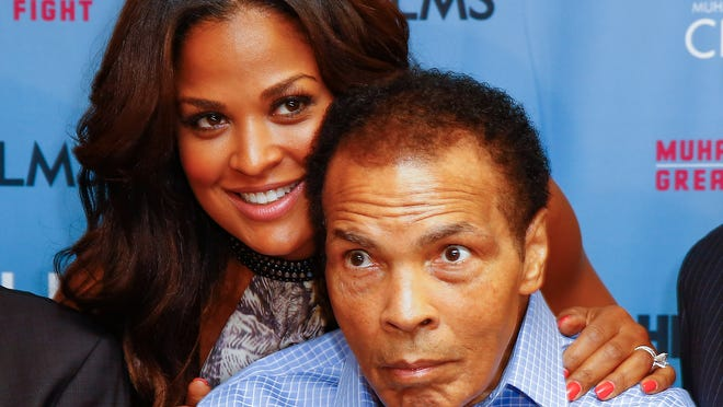 """Laila Ali and her dad, Muhammad Ali, appear as HBO Films and the Muhammad Ali Center to co-host the U.S. Premiere of """"Muhammad Ali's Greatest Fight"""" at Muhammad Ali Center on Wednedsday in Louisville."""