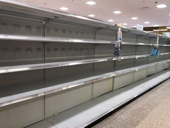 Water aisle at Publix in Naples Plaza across from Coastland