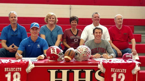 Hendersonville seniors Michael Schmidt, left, and Michael Cook have signed to play college football.