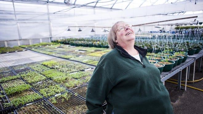 Marcia Bundi laughs while discussing gardening and growing processes at Bundi Gardens.