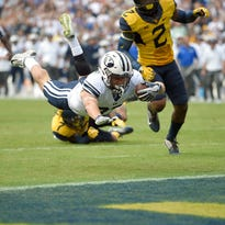 Howard and West Virginia hold off Hill and BYU 35-32