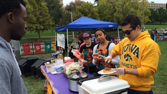 Members of the University of Iowa American Indian Student Association and Association of Latinos Moving Ahead serve tacos made with Native American fry bread at the last UI Cultural Diversity Festival on Sunday.