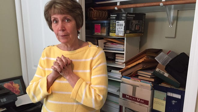 """Jeanne Nordstrom stands in front of the closet containing the materials she used while writing """"Permission to Teach."""" """"This is what it looks like to write a book,"""" she said."""
