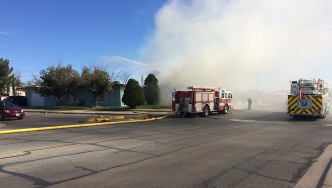 El Paso Fire Department officials respond to a house fire in the 4800 block of Yandell Drive.