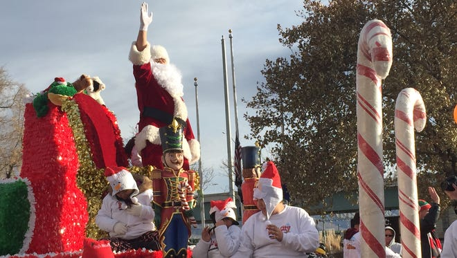 A float carrying Santa makes its way down Victorian Avenue during the Sparks Hometowne Christmas Parade.