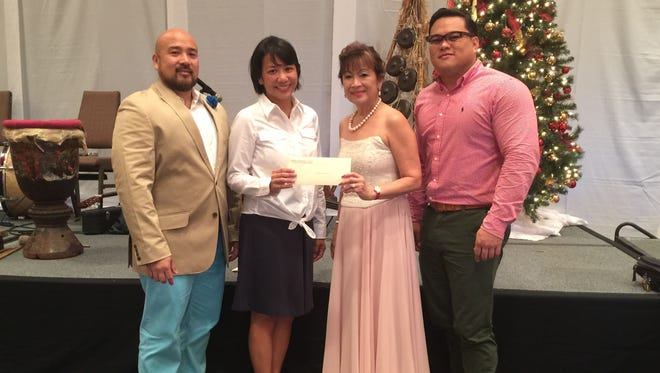 The Filipino Community of Guam donated $250 to five local non-profit organizations. One such organization was Big Brothers Big Sisters of Guam. Pictured from left: Norman Analista, FCG 1st vice president, Vanessa Estella, BBBSG executive director, Nita Baldovino, FCG president and Roberto Laanan, BBBSG volunteer.
