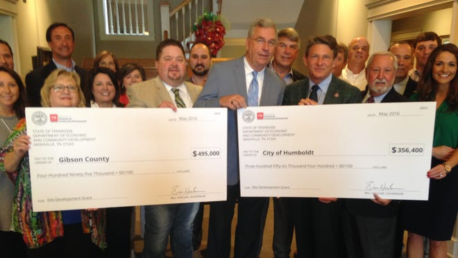 Tom Witherspoon, Gibson County mayor; Marvin Sikes, mayor of Humboldt, Randy Boyd, commissioner of economic and community development in Tennessee and State Rep. Curtis Halford (R-Dyer) during check presentation in Humboldt, Tuesday.