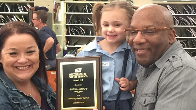 (From left) Jennifer Kraft, her daughter Sophia Kraft and her husband, Kory Kraft. Three-year-old Sophia was recognized as an honorary letter carrier Tuesday by the Sewell Post Office