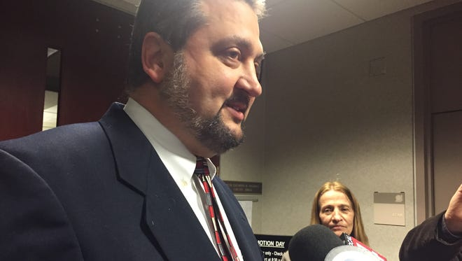 Frank Cusumano, a private attorney for Macomb County Clerk/Register of Deeds Karen Spranger, and Spranger talk with the media after a hearing Macomb County Circuit Court on May 10, 2017 after the county sued Spranger, who objected to two of her offices moving to a newly-renovated space on May 15, 2017.