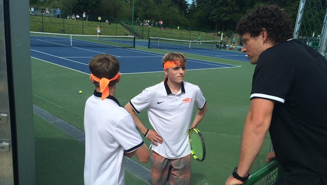 Sprague's Logan and Judd Blair talk with coach Uriah Jones on Friday during their state semifinal match.