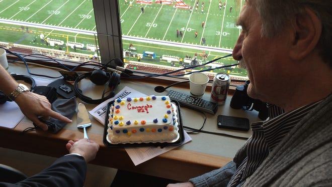 Ed Podolak with pre-game cake celebrating his 400th radio game