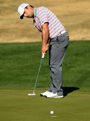 Francesco Molinari putts on the eighth green at the Palmer Private Course at PGA West during the opening round of the Humana Challenge on Thursday, January 22, 2015 in La Quinta, Calif. Molinari finished -8 on the day.