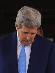 U.S. Secretary of State John Kerry leaves after a meeting