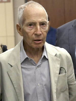 Robert Durst leaves a Houston courtroom in this 2014 photo. He was arrested Saturday in New Orleans for a Los Angeles murder. FILE - In this Aug. 15, 2014 file photo, New York City real estate heir Robert Durst leaves a Houston courtroom. Durst was arrested in New Orleans on an extradition warrant to Los Angeles on Saturday, March 14, 2015. (AP Photo/Pat Sullivan, File)