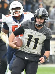 Quarterback David Blough runs the option Saturday at